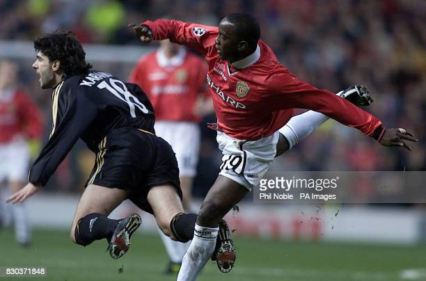 This picture can only be used within the context of an editorial feature Manchester United's Dwight Yorke tangles with Real Madrid's Aitor Karanka...