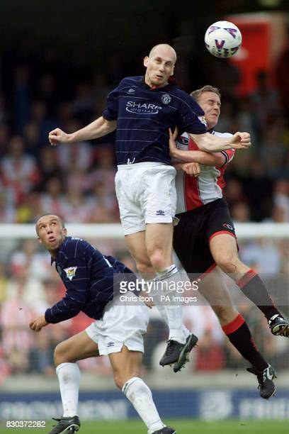This picture can only be used within the context of an editorial feature Manchester United's Jaap Stam and Southampton's Kevin Davies jump for the...