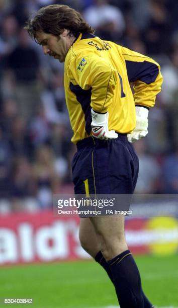 This picture can only be used within the context of an editorial feature England goalkeeper David Seaman looks dejected following Portugal's first...
