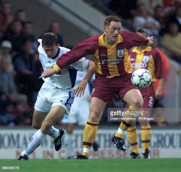 This picture can only be used within the context of an editorial feature Bradford City's David Hopkin battles with St Petersburgs Igor Nedorezov...