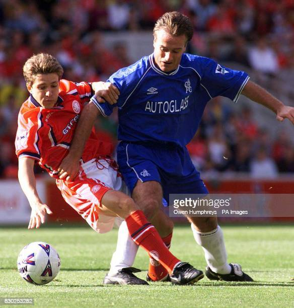 This picture can only be used within the context of an editorial feature Middlesbrough 's Juninho battles with Chelsea 's Didier Deschamps during...