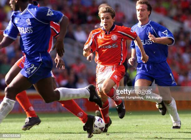 This picture can only be used within the context of an editorial feature Middlesbrough 's Juninho is chased by Chelsea 's Didier Deschamps as he...