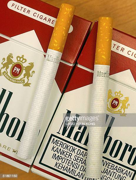 This picture dated 15 December 2004 shows a genuine pack of Philip Morris's best selling Marlboro cigarettes displayed side by side with an alleged...