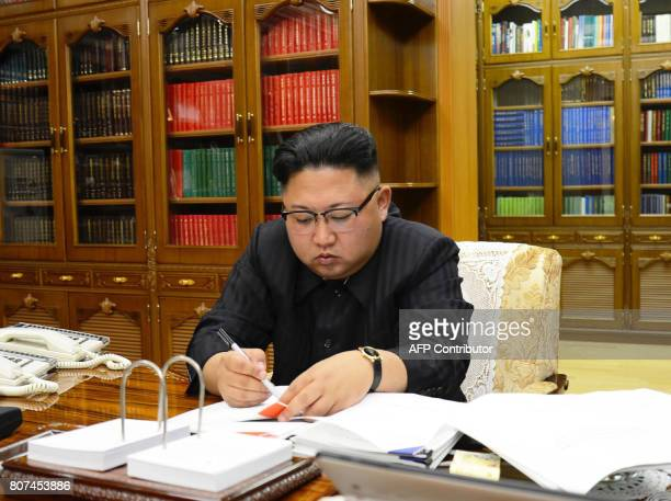 This picture from North Korea's official Korean Central News Agency taken on July 3 2017 and released on July 4 2017 shows North Korean leader Kim...