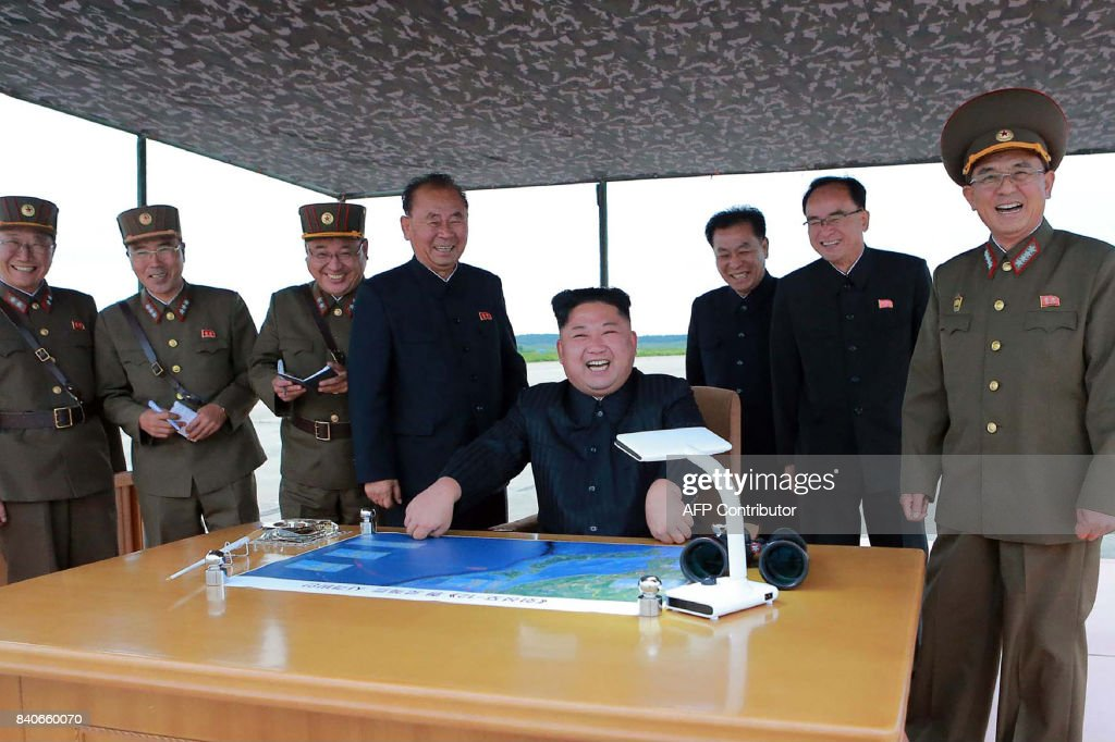TOPSHOT - This picture from North Korea's official Korean Central News Agency (KCNA) taken on August 29, 2017 and released on August 30, 2017 shows North Korean leader Kim Jong-Un (C) watching the launch of an intermediate-range strategic ballistic rocket Hwasong-12 at an undisclosed location near Pyongyang. Nuclear-armed North Korea said on August 30 that it had fired a missile over Japan the previous day, the first time it has ever acknowledged doing so. / AFP PHOTO / KCNA VIA KNS / STR / South Korea OUT / REPUBLIC OF KOREA OUT ---EDITORS NOTE--- RESTRICTED TO EDITORIAL USE - MANDATORY CREDIT 'AFP PHOTO/KCNA VIA KNS' - NO AFP. / The erroneous mention[s] appearing in the metadata of this photo by STR has been modified in AFP systems in the following manner: [at an undisclosed location near Pyongyang] instead of [in Pyongyang]. Please immediately remove the erroneous mention[s] from all your online services and delete it (them) from your servers. If you have been authorized by AFP to distribute it (them) to third parties, please ensure that the same actions are carried out by them. Failure to promptly comply with these instructions will entail liability on your part for any continued or post notification usage. Therefore we thank you very much for all your attention and prompt action. We are sorry for the inconvenience this notification may cause and remain at your disposal for any further information you may require.