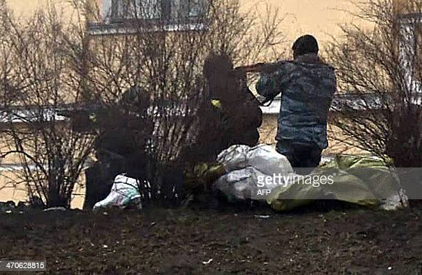 This picture grabbed on AFP TV images shows governmental soldiers firing onto demonstrators in Kiev on February 20 2014 Ukraine's brittle truce...