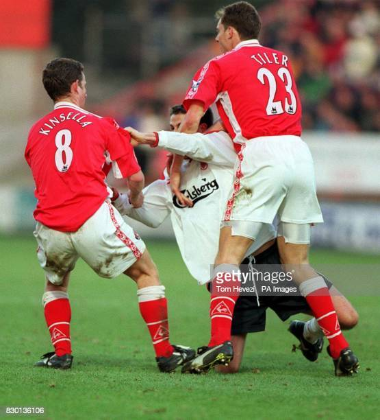 This picture may only be used within the context of an editorial feature Charlton Athletics's Mark Kinsella scuffles with Liverpool's Jamie Redknapp...