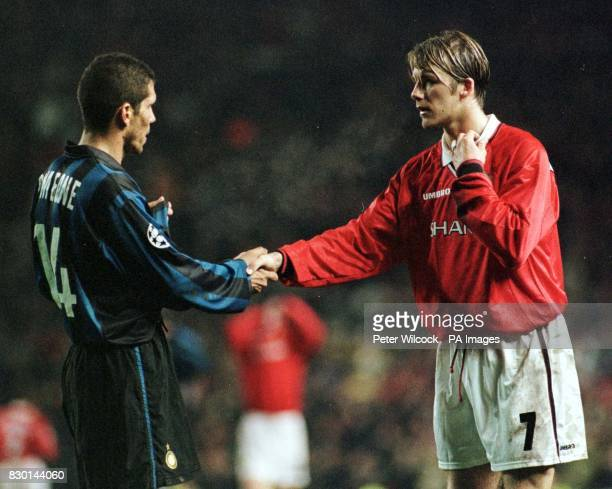 This picture may only be used within the context of an editorial feature Manchester United's David Beckham exchanges shirts with Diego Simeone of...