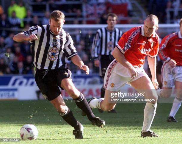 This picture may only be used within the context of an editorial feature Newcastle United's Alan Shearer is challenged by Manchester United's Jaap...