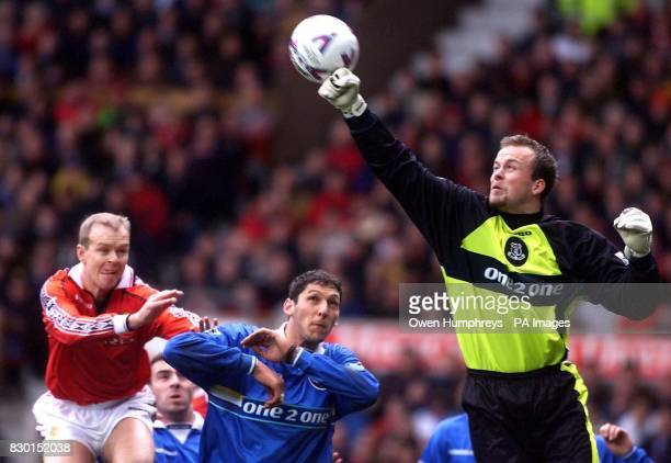 This picture may only be used within the context of an editorial feature Manchester Utd's Henning Berg charges foward as Everton's keeper Thomas...