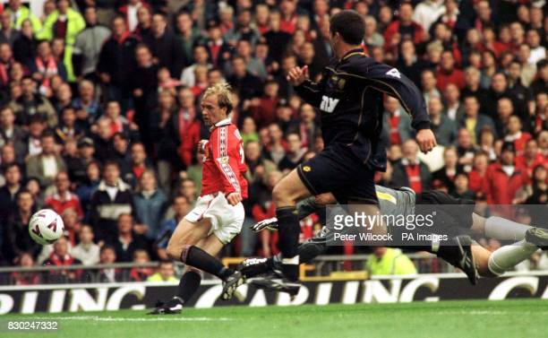 This picture may only be used within the context of an editorial feature Jordi Cruyff puts the ball past Wimbledon goal keeper Neil Sullivan to score...