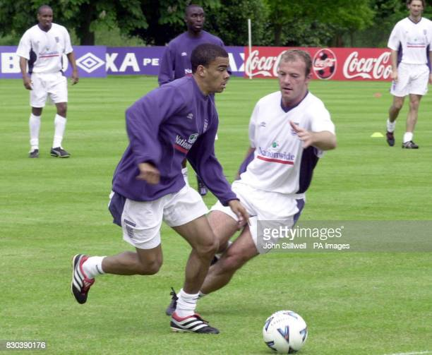 This picture may only be used within the context of an editorial feature England footballers Kieron Dyer wins the ball from Alan Shearer during a...