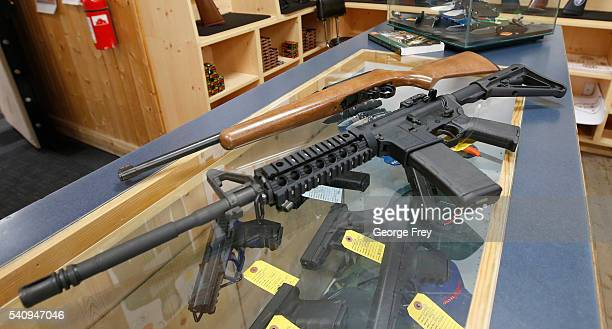 This picture of an AR15 and a Ruger 1022 both semiautomatic guns at Action Target on June 17 2016 in Springville Utah Semiautomatics are in the news...