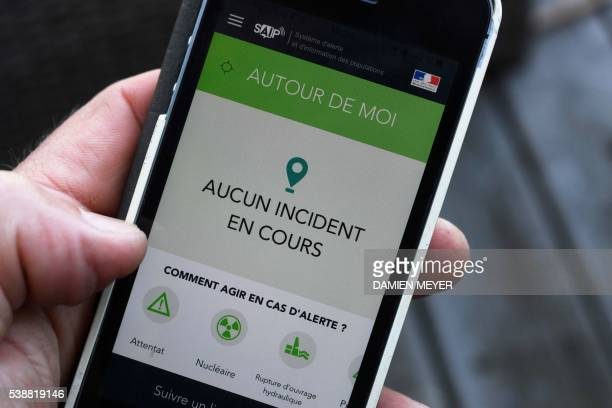 This picture on June 8 2016 in Dinard western France shows a smartphone screen reading 'Around me No ongoing incidents' displayed on a page of the...