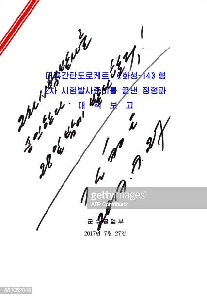 This picture released from North Korea's official Korean Central News Agency on July 29 2017 shows an order document of test launch of an...