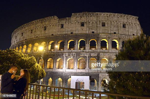 This picture shows a couple chating outside of the Colosseum during a preview of the night tour 'The moon over the colosseum' late on May 2 2013 in...