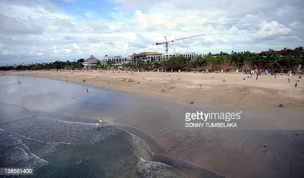 This picture shows a general view of Kuta beach on Indonesia's resort island of Bali on February 92012 The beauty of Bali allures thousands of...