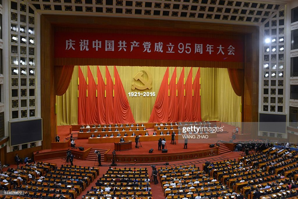 This picture shows a general view of The Celebration Ceremony of the 95th Anniversary of the Founding of the Communist Party of China at the Great Hall of the People in Beijing on July 1, 2016. China's Communist Party take the ruling organisation's membership to almost 88 million and the anniversary of the Party's founding falls on July 1. / AFP / WANG