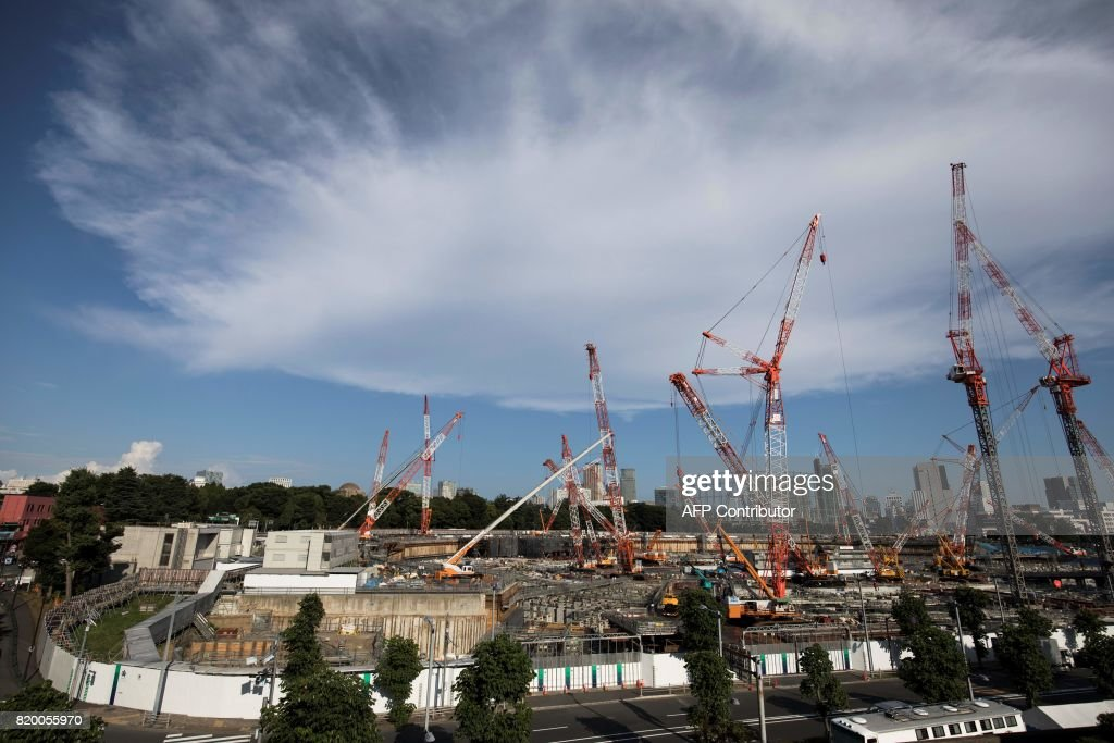 This picture shows a general view of the construction site for the National Stadium, venue for the upcoming Tokyo 2020 Olympic Games, in Tokyo on July 21, 2017. The suicide of a 23-year-old worker on Tokyo's Olympic stadium was due to overwork, his family said on July 21, as Japan races to finish building venues for the 2020 Games. / AFP PHOTO / Behrouz MEHRI