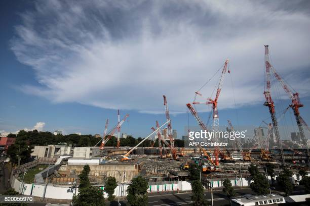 This picture shows a general view of the construction site for the National Stadium venue for the upcoming Tokyo 2020 Olympic Games in Tokyo on July...