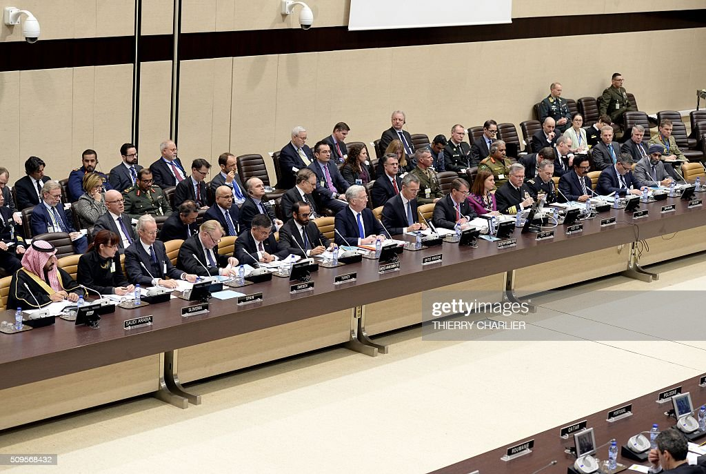 This picture shows a general view of the proceedings during the Global Coalition meeting against the Islamic State group IS held at NATO headquarter in Brussels on February 11, 2016. / AFP / THIERRY CHARLIER