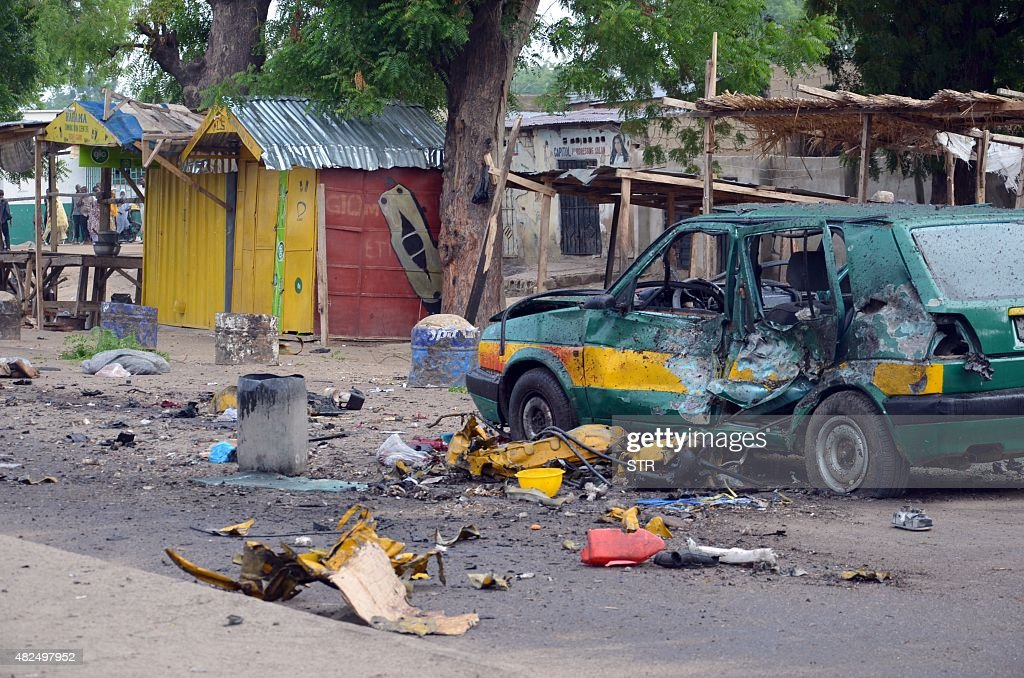 This picture shows a general view of the scene of an Improvised Explosive Device (IED) blast at Gomboru market in Maiduguri, Borno State in northeastern Nigeria on July 31, 2015 detonated by a female suicide bomber who arrived on a taxi tricycle killings at least eight people and several other. A female suicide bomber blew herself up at a big market in the northeast Nigerian city of Maiduguri, a vigilante and a witness said.