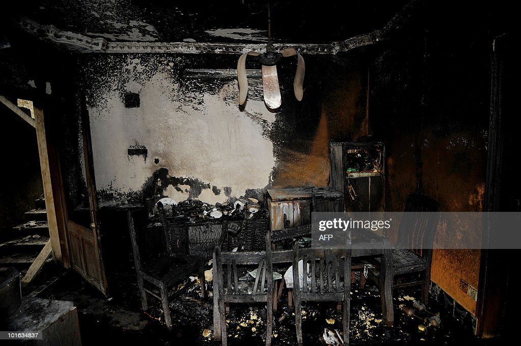 This picture shows a living room at the site of a burnt-out house in Old Dhaka on June 5, 2010. The national flag flew at half-mast and people of all faiths joined prayers as Bangladesh mourned the deaths of nearly 120 people in the country's deadliest blaze.