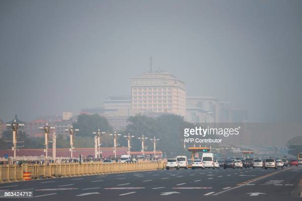 This picture shows a main road leading to Tiananmen Square on a polluted day during the Communist Party's 19th Congress in Beijing on October 20 2017...