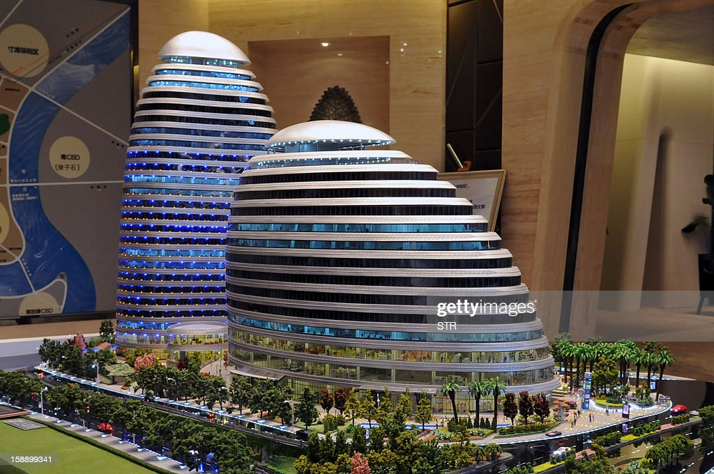 This picture shows a model of the Meiquan 22nd Century building in China's southwest Chongqing on January 3, 2012. Already famed for fake designer bags and pirated DVDs, imitation in China may have reached new heights with a set of towers that strongly resemble ones designed by renowned architect Zaha Hadid. It could rank among the more flagrant ripoffs in a country already notorious for imitating foreign products without permission -- but the developer of the Chongqing project, Meiquan 22nd Century, has denied any copying. CHINA