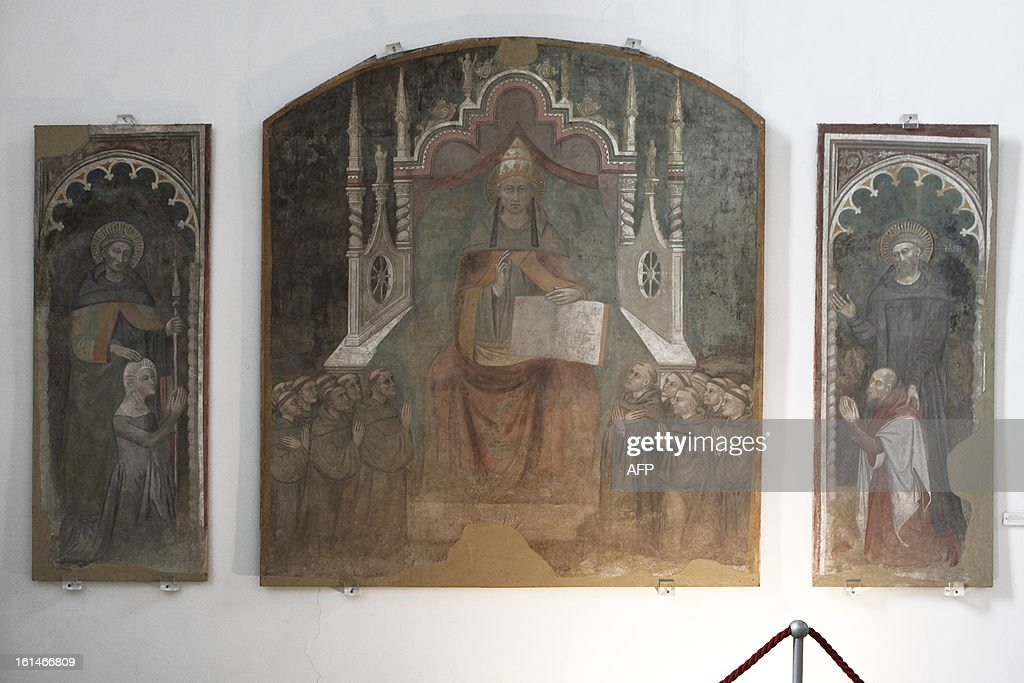 This picture shows a painting of Pope Celestine V by Italian painter Niccolo' Di Tommaso (Florence, Italy 1346-1376) in the museum of CatelNuovo in Naples on February 11, 2013. Pope Benedict XVI announced on February 11, 2013 his resignation, while the last pope to have abdicated the papacy is Celestine V in 1294. AFP PHOTO / ROBERTA BASILE