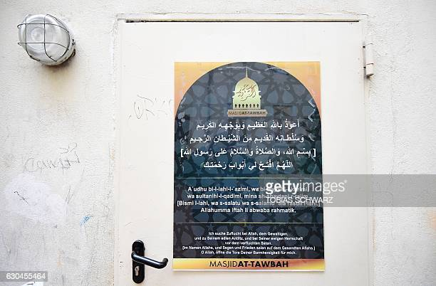 This picture shows a poster in the compound of a mosque in Berlin on December 23 where Tunisian Anis Amri the suspected Christmas market attacker was...