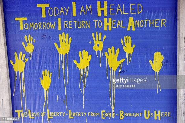 This picture shows a tarp with words and handprints in yellow paint in US treatment unit for Liberian healthcare workers infected with Ebola during...