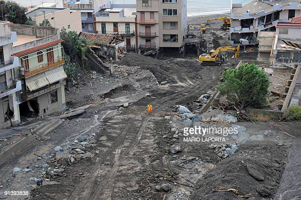 This picture shows a view of houses in Scaletta Zanclea near Messina following torrential rains and mudslides on October 4 2009 At least 22 people...