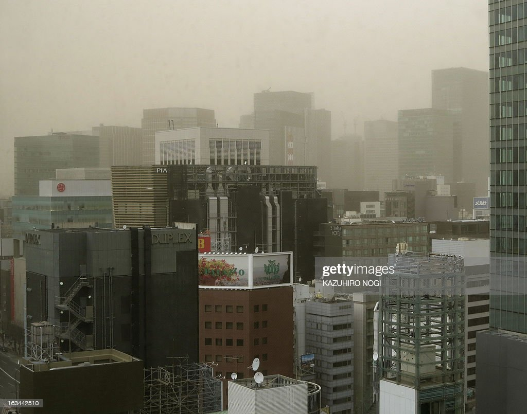 This picture shows a view of Tokyo's shopping district Ginza being hit by a dust storm on March 10, 2013. A huge dust storm hit Tokyo, blanketing the city with brown dust that blinded many residents and slightly darkened the city, as the cold front quickly moved south, meteorologists said.