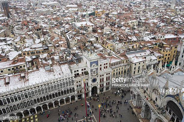 This picture shows a view of Venice covered with snow taken from St Mark's campanile on the last day of the carnival on February 12 2013 in Venice...