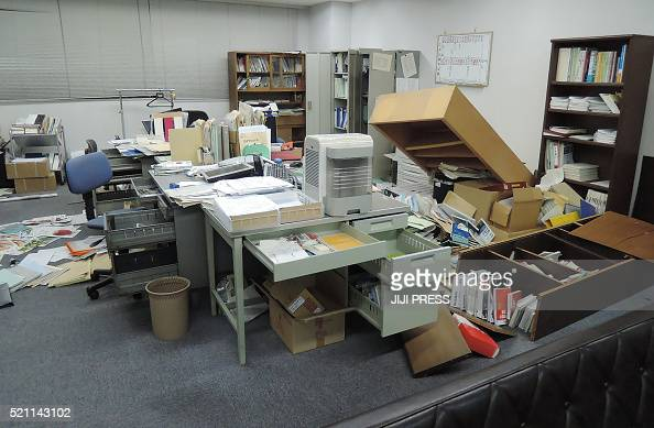 This picture shows an office following an earthquake in Kumamoto city on April 14 2016 The strong 64magnitude earthquake struck at 926 pm in Kumamoto...