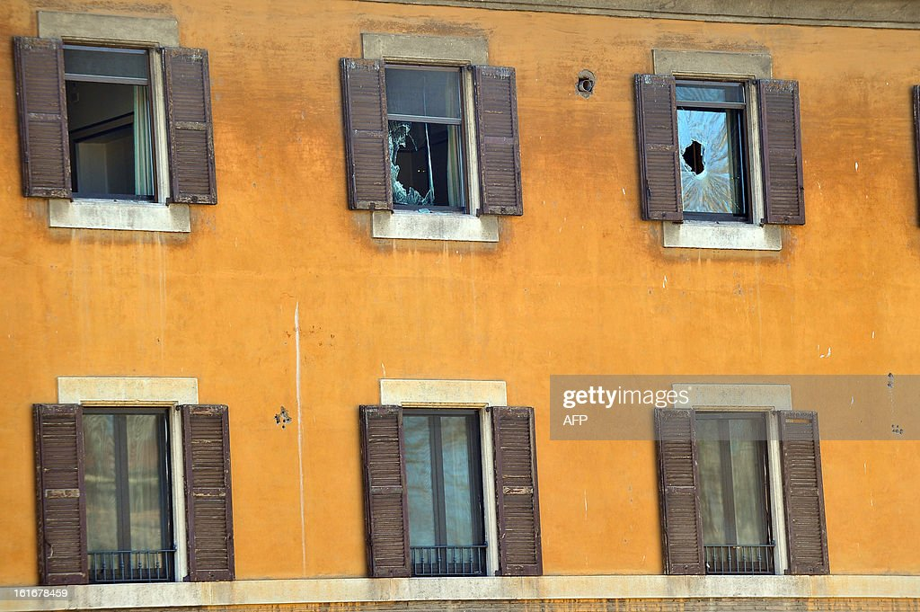 This picture shows broken windows after a fire in the Fatebene Fratelli hospital on the Tiberina island in Rome on February 14, 2013. The fire started in the department of psychiatry.
