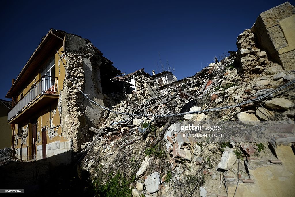 This picture shows damaged building following the 2009 earthquake on October 22 2012 in the village of Onna Six Italian scientists and a government...