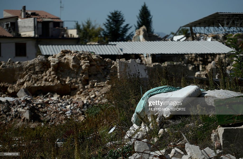This picture shows damaged buildings following the 2009 earthquake on October 22 2012 in the village of Onna Six Italian scientists and a government...