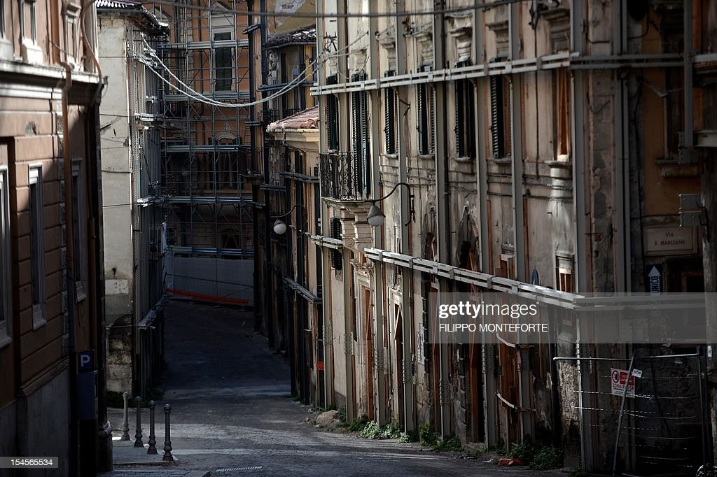 This picture shows damaged buildings on October 22 2012 in L'Aquila Six Italian scientists and a government official were found guilty the same day...