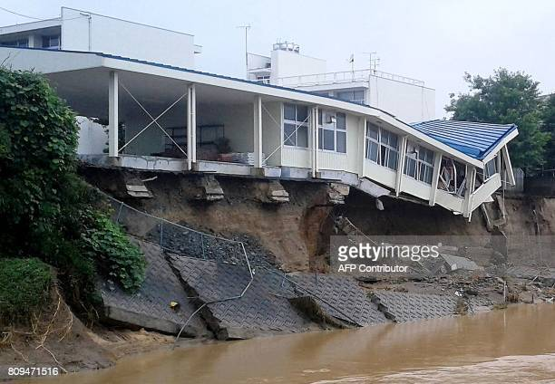 This picture shows damaged from flood to Hiramatsu Junior High School in Asakura Fukuoka prefecture on July 6 2017 At least 15 people are missing...
