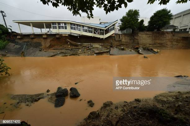 This picture shows Hiramatsu Junior High School damaged following heavy flooding in Asakura Fukuoka prefecture on July 6 2017 At least two people...