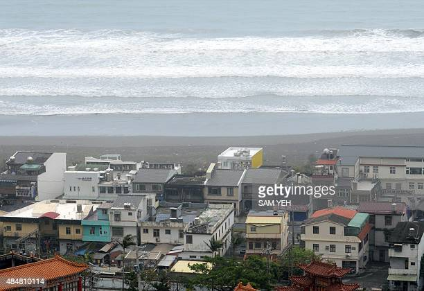 This picture shows long waves hitting the shore line near the Wushih harbor in Yilan as typhoon Goni approaches in eastern Taiwan on August 22 2015...