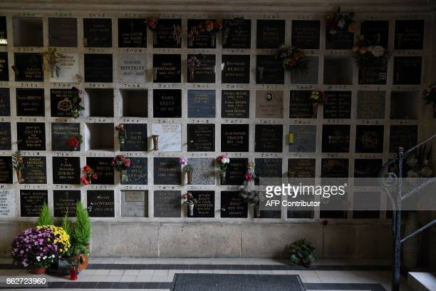 This picture shows name plates covering funeral urns at the crematorium at Le Pere Lachaise cemetery in Paris on October 17 2017 / AFP PHOTO /...