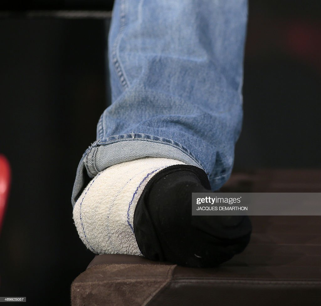 This picture shows new pole vault world record holder France Renaud Lavillenie's bandaged foot as he gives a press conference in Paris, on February 17, 2014, two days after setting the new world mark of 6.16 metres in Donetsk. The Frenchman later opened a wound on the inside of his left ankle after falling back while attempting to clear 6.21 metres. 'I am withdrawing (from the world indoors in Poland) because I have a big laceration, but it is nothing too serious,' the Olympic champion told a news conference.