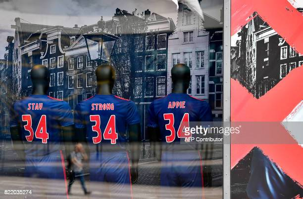 This picture shows puppets in a fanshop wearing shirts with the number 34 of Ajax midfielder Abdelhak Nouri reading 'Stay strong Appie' in Amsterdam...