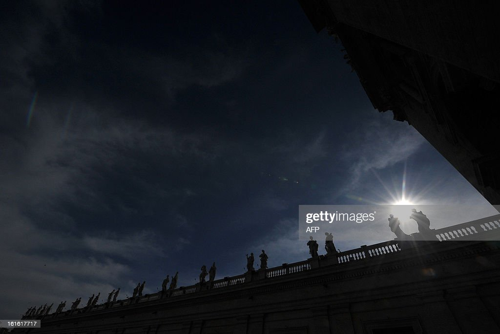 This picture shows statues on the colonnade of St Peter's square on February 13, 2013 at the Vatican. Pope Benedict XVI made his first public appearance on Wednesday since his shock resignation announcement, asking thousands of cheering pilgrims at the Vatican to 'keep praying for me'.