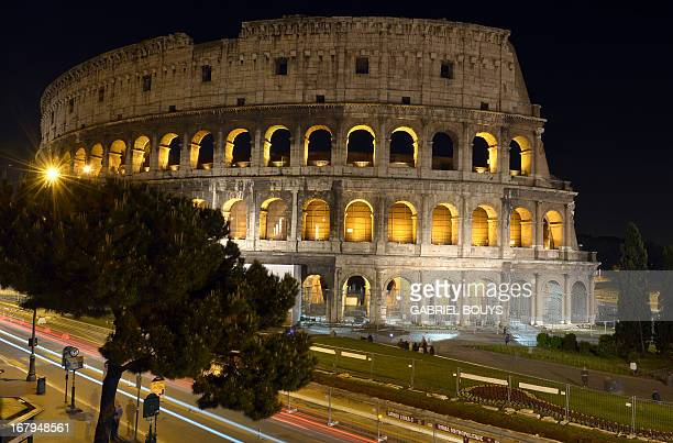 This picture shows the Colosseum during a preview of the night tour 'The moon over the colosseum' late on May 2 2013 in Rome 'The moon over the...