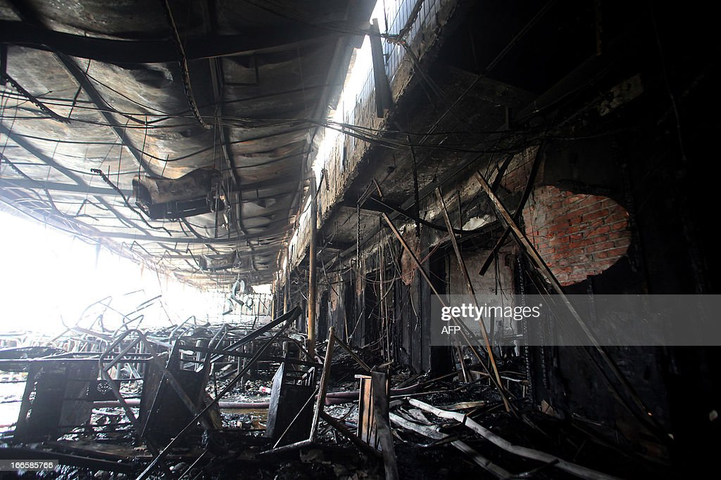 This picture shows the damage after a hotel caught fire in Xiangyang, central China's Hubei province on April 14, 2013. The fire, started from an Internet cafe downstairs, resulted in 11 deaths and 50 injuries, local government reports annouced. CHINA