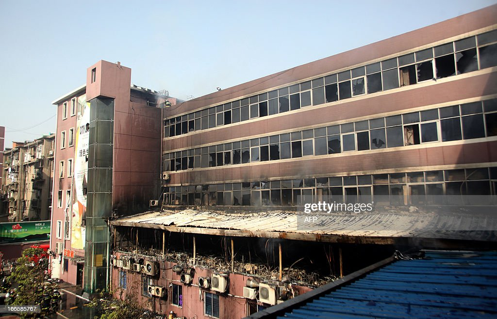 This picture shows the damage after a hotel caught fire in Xiangyang, central China's Hubei province on April 14, 2013. The fire, started from an Internet cafe downstairs, resulted in 11 deaths and 50 injuries, local government reports annouced. CHINA OUT AFP PHOTO